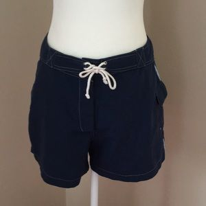 Blue shorts with side stripes and one cargo pocket
